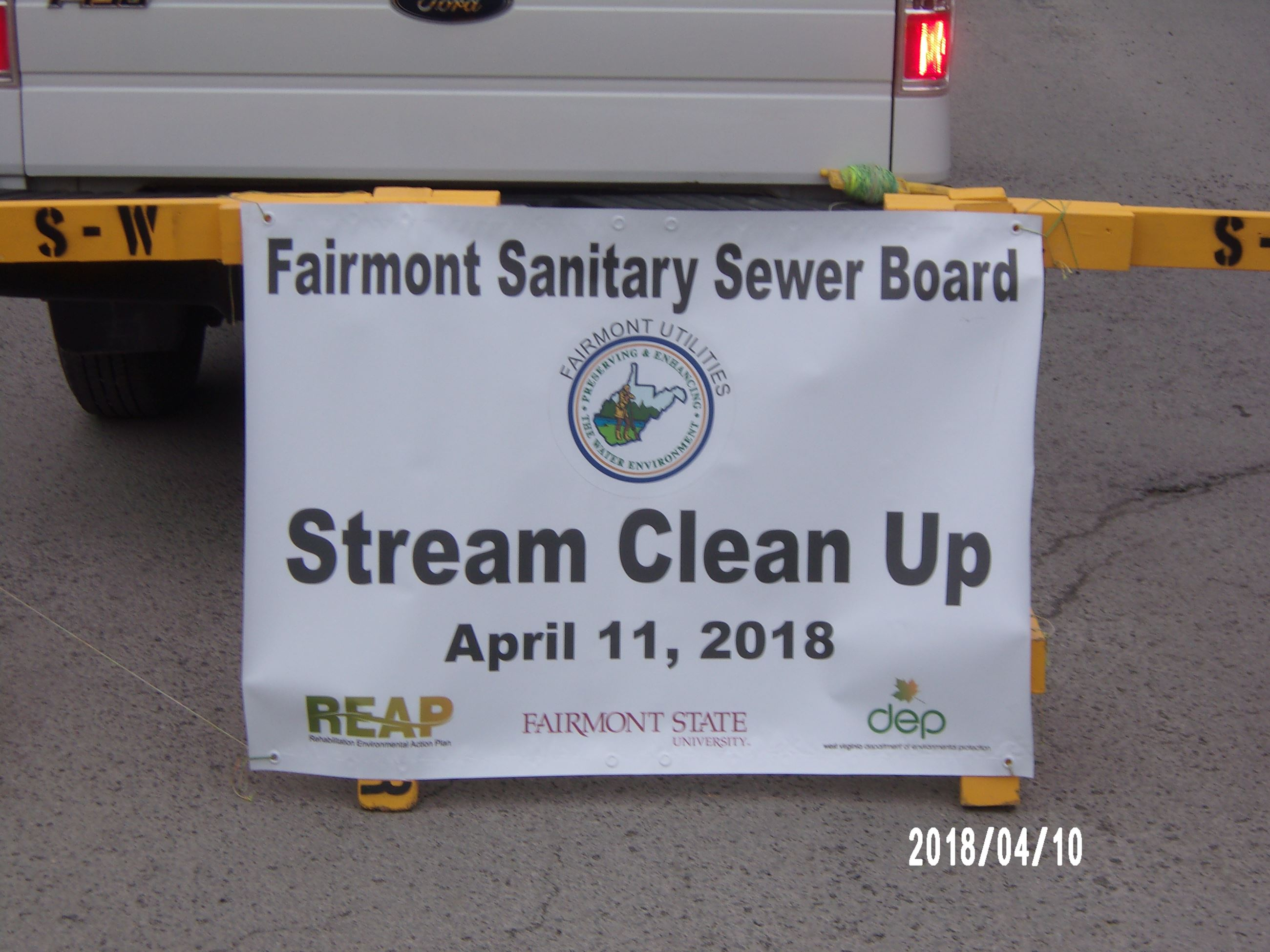 Fairmont Sanitary Sewer Board Stream Clean Up Sign